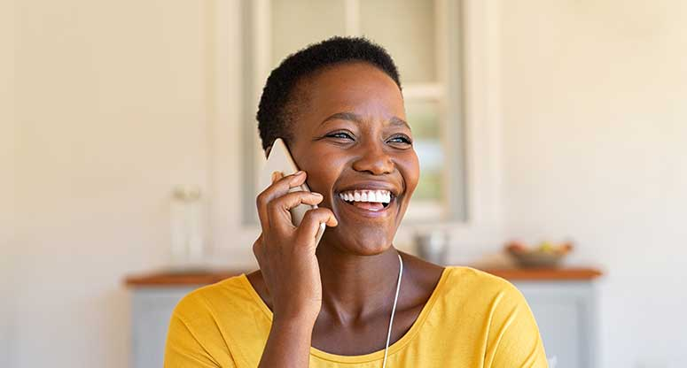 happy woman talking on the phone to work at home customer service agent